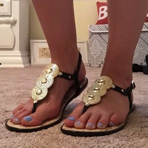 Black and gold rubber sandals